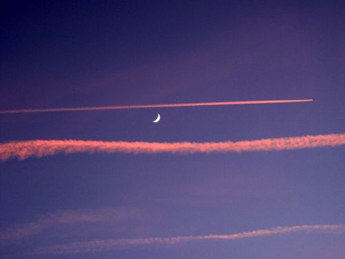 Moon wrapped in vapour trails above Sarlat