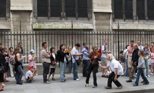 Street performer outside Notre Dame