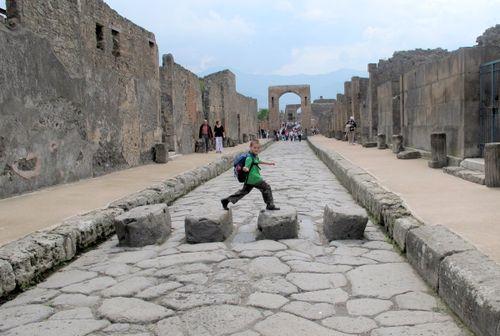 Hopping across the main street in Pompeii