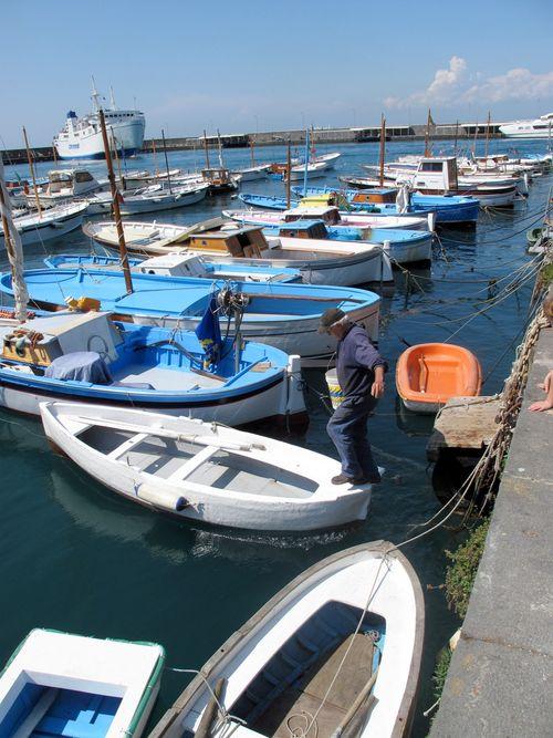 Fisherman dancing on boats in Capri Harbour